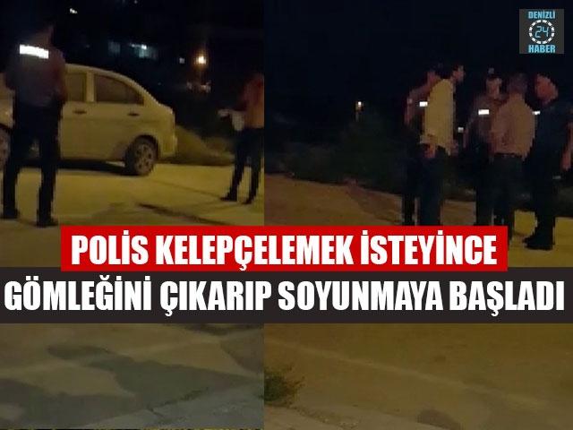 Polis Kelepçelemek İsteyince Gömleğini Çıkarıp Soyunmaya Başladı