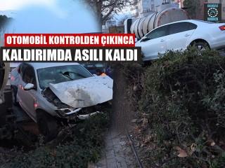 Otomobil Kontrolden Çıkınca Kaldırımda Asılı Kaldı